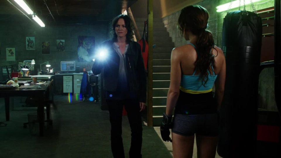 Sara in the vigilante's basement